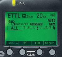 Choix flash cobra : mode d'exposition TTL ou manuel (illustration du mode TTL sur l'écran arrière d'un flash cobra)